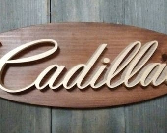 Cadillac Script Emblem Oval Wall Plaque-Unique scroll saw automotive art created from wood.