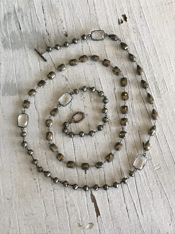 Eternal Optimist. Pyrite beads with faceted crystals. Long necklace. Handmade and OOAK by ladeDAH!
