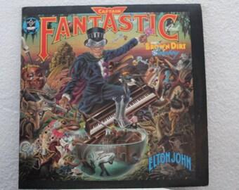 "Elton John - ""Captain Fantastic"" vinyl record w/ Lyrics booklet, Scrap booklet, and Poster"