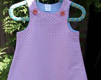 Pretty little Pinafore with button fastening.