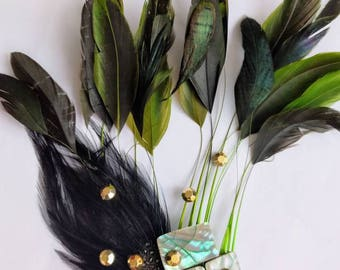 Green feather hair comb with gold and blue accents