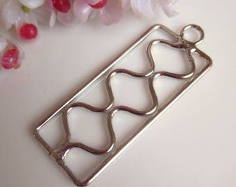 pretty openwork rectangular silver metal pendant