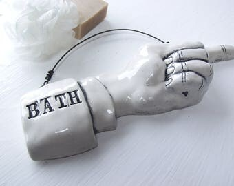 Bath Pointing Finger.  Fired Ceramic.  Recycled Clay.  Bathroom Sign.  Ready To Ship.  Acme Art Company.