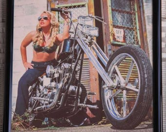 16x20 inch framed poster of a blonde chopper babe in blue jeans