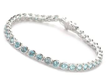 "Sterling Silver 11.32ctw Round Blue Zircon Tennis Bracelet SZ 7.25"""