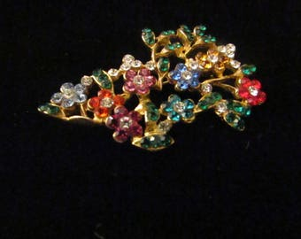 Vintage Rhinestone Brooch. Spray of many flowers all blooming in different colors, photos do not do justice to the sparkle effect. Beautiful