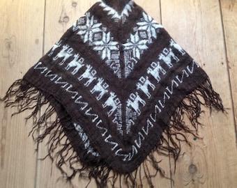Knit poncho -  Iceland?