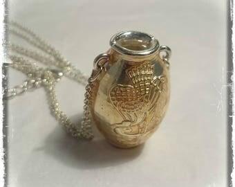 Unusual silver vase pendant necklace