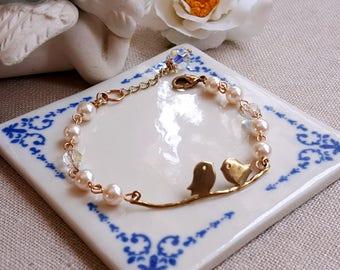 Swarovski pearls and Swarovski AB clear crystals Bird on branch bracelet Swarovski jewelry