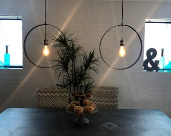 Black steel ring pendant light with brass accents and included LED blub.