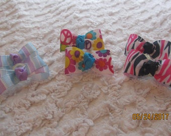 Dog Hair Bows Can Mix and match with any of my bows, blue and purple stripped, flower power, hot pink and black zebra, dog bows, bows