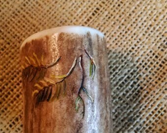 "toothpick holder, made of Elk Antler, with an original carving/painting (green pine boughs/limbs) about 2-1/4"" high (opening about 1-1/2"")"