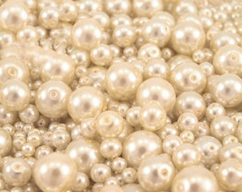 61-B - 100 g of 4-12 mm glass pearl beads different sizes