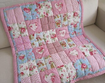 HANDMADE Patchwork Cot Quilt and Decorative Padded Heart with Strawberry Shortcake fabric.