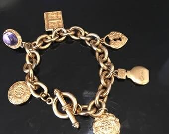 Vintage 1970's charm bracelet. It is a signed piece by Gloria Vanderbuilt.