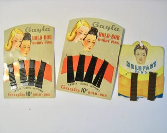 Vintage beauty shop merchandise. NOS in package. Bobby pins from Gayla, Holdfast. Black and brown hair pins. 1940s-1950s hair accessories.