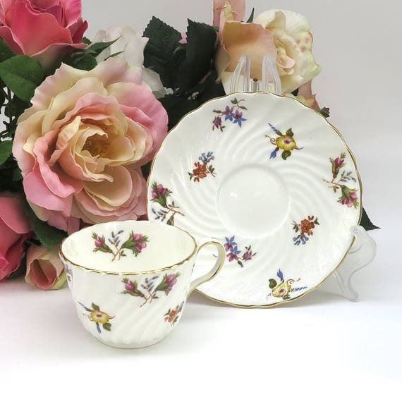 Aynsley cup and saucer, white with scattered mult icolored flowers, Gaiety pattern, gilt trimmed, bone china, England, 1930s