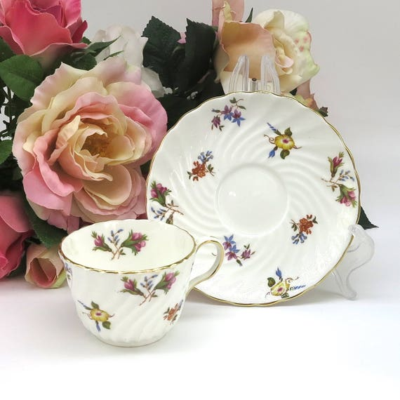 Vintage Aynsley cup and saucer, white with scattered mult icolored flowers, Gaiety pattern, gilt trimmed, bone china, England, 1930s