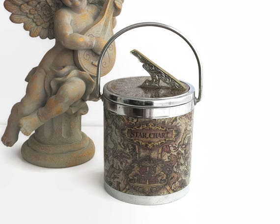 Vintage ice bucket with Zodiac signs and sundial shaped handle, chrome and lacquered paper with plastic inner bucket, mid 20th century