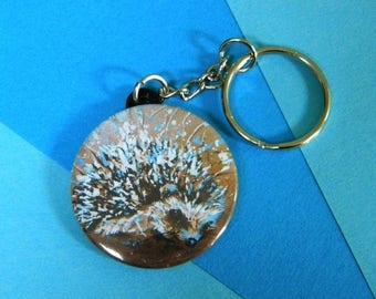 Keychain with a hedgehog on Brown background