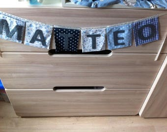 """""""pockets"""" square with name in shades of blue Garland"""