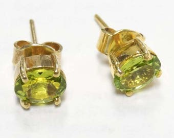 A Pair of 18k Yellow Gold Earrings set with Peridots, Stud Earrings, Peridot Earrings