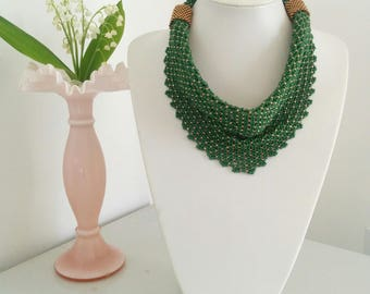 Green beaded skarf with two bronze embellishments
