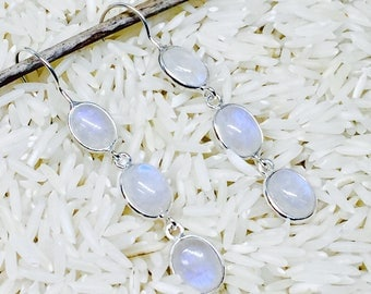 Rainbow moonstone earrings set in Sterling silver 92.5.. Length- 1.5 inch long. Perfectly matched natural moonstones.