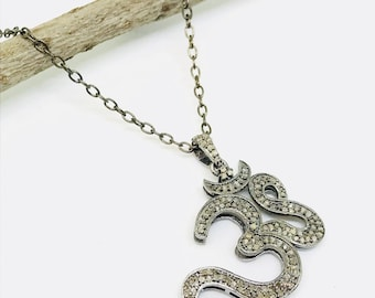 Pave diamond OM pendant set in sterling silver (92.5). Authentic natural diamonds .