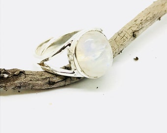 Rainbow moonstone adjustable ring set in Sterling silver 92.5.Natural authentic rainbow moonstone .