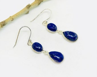 Lapis lazuli earring set in sterling silver 92.5. Genuine authentic natural lapis lazuli stones. Perfectly matched. Length- 1.22 inch long .