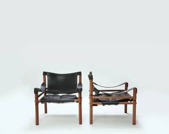 A pair of Arne Norell safari sirocco chairs, rosewood and leather, Sweden, 1960s
