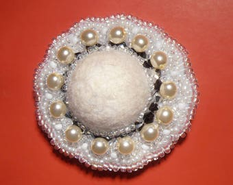 Round brooch with pearls and seed beads with felted wool cabochon
