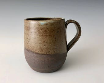 Modern handmade pottery coffee/tea cup earth tones with blue highlights Haight Pottery Company