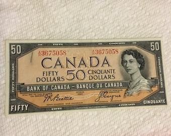 50.00 bill in plastic holder - 1954 - #058