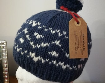Wool hat with jacquard workmanship in blue and white and pompoms age 3/4 years
