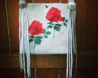 Leather purse with embroiderd roses.