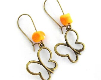 Orange glass beads and bronze metal butterfly earrings
