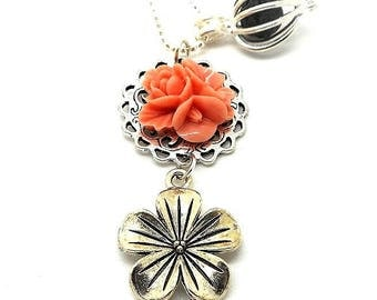 A scent! Necklace has perfume, silver rose flower