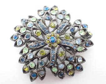 Signed Selini brooch in shades of blue and green rhinestones AB045