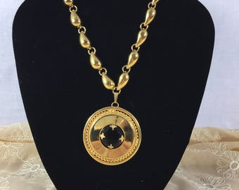 MONET Vintage gold necklace with Circular pendent and amber stone