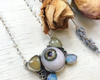 Creep- Prosthetic Eye with Sapphire and Opal necklace