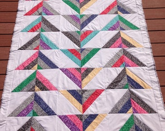 Colorful handmade geometric lap quilt