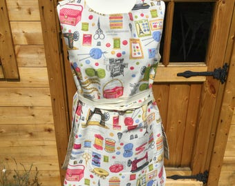 Long length tabard with pocket in sewing inspired fabric