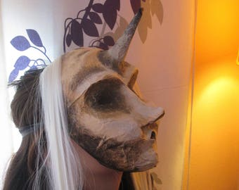 Mask from paper mache. Unicorn. It blows. Fairy. Spell.