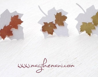 handmade earrings with fretsaw with maple leaf shaped