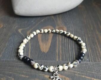Delicate Ohm, gemstones bracelet Jasper Dalmatian and matte black onyx.