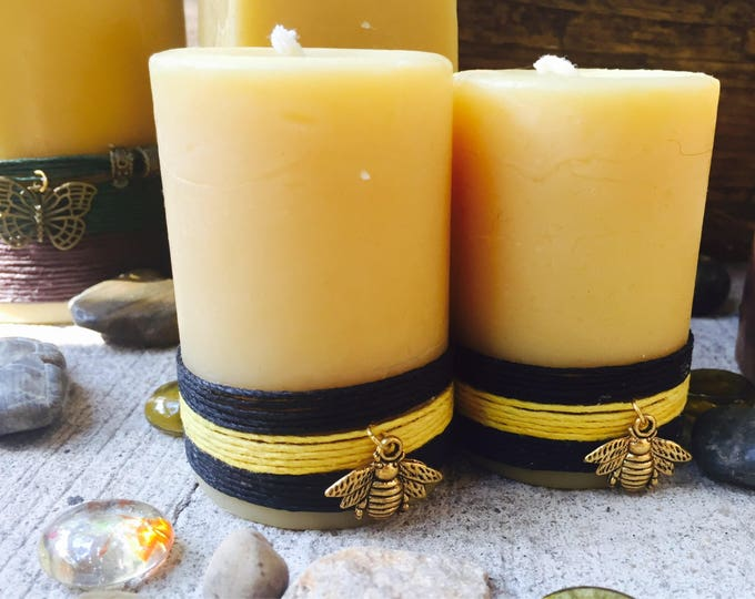 100% Beeswax Pillar Candle wrapped in natural hemp & charmed with a Honeybee