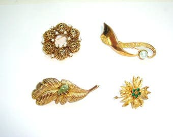 Costume jewelry lot of Brooches. 4 Brooches. Gold tone brooch lot. Rhinestones, faux pearls. All classics. All in good used condition.