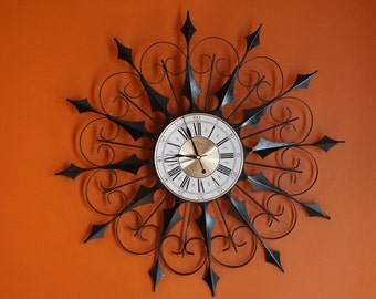 elgin mcm wrought iron wall clock starburst clock sunburst clock style